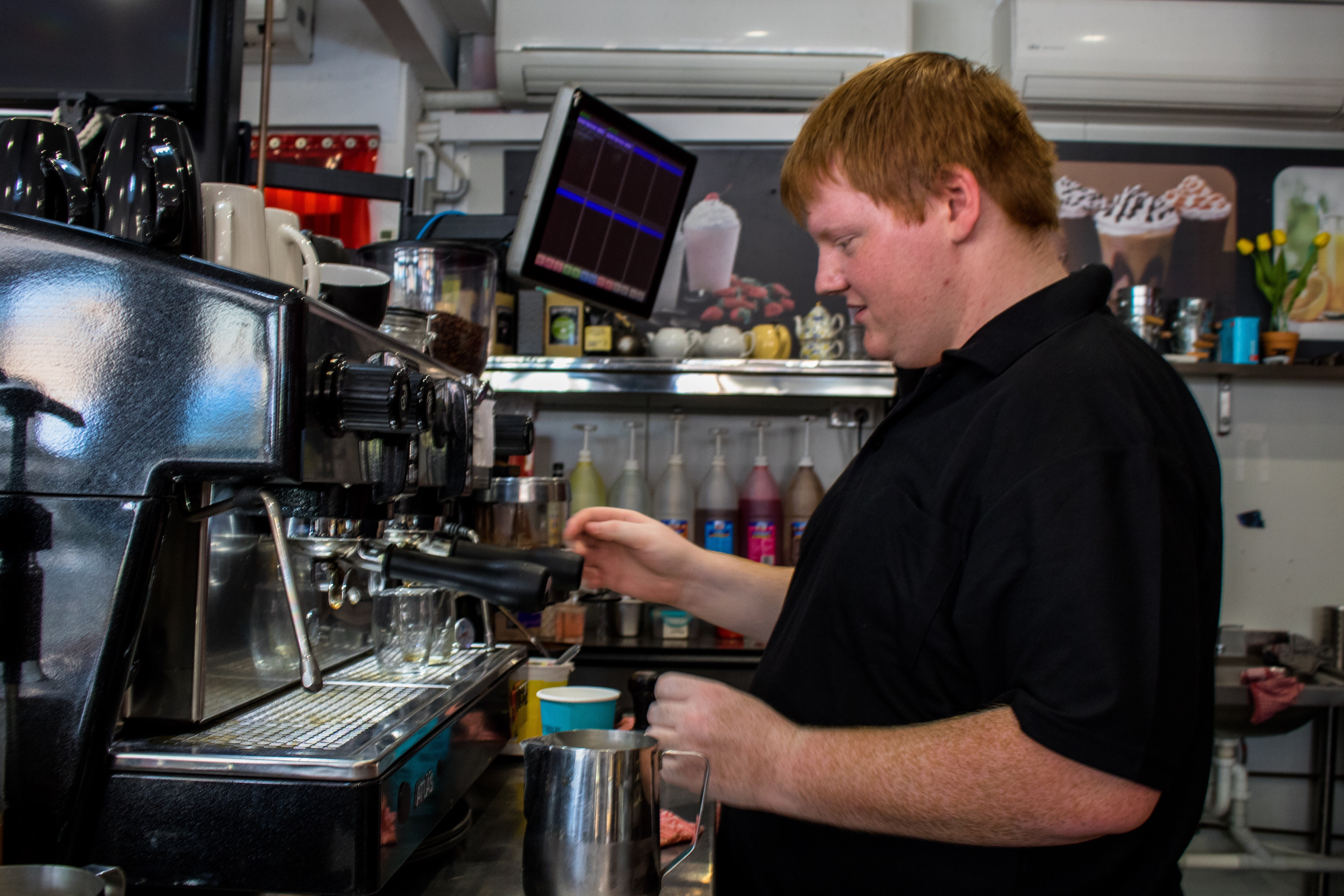 Zach lands his first job out of school at a friendly, local café