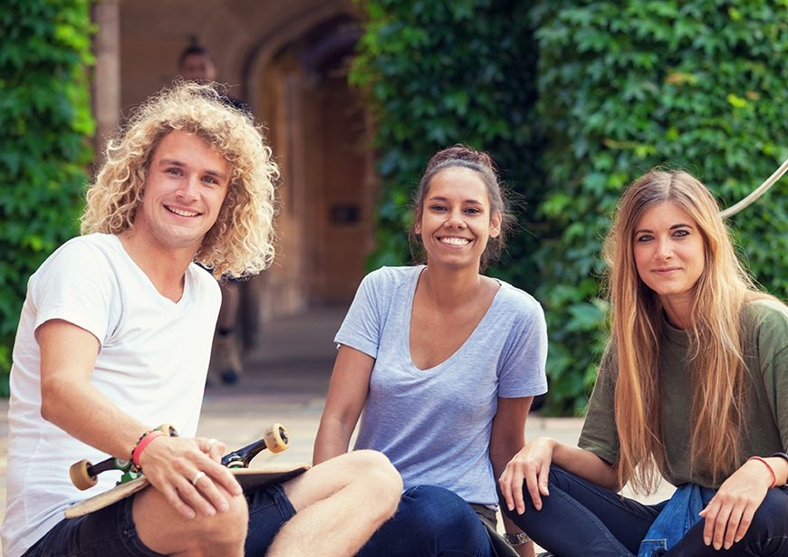 Young adults smiling and looking at the camera